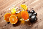 Orange bath salt, essential oil and ripe fruits — Stockfoto