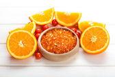 Orange bath salt - fruits and aromatherapy minerals — Stock Photo