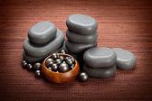 Spa massage - black stones — Stock Photo