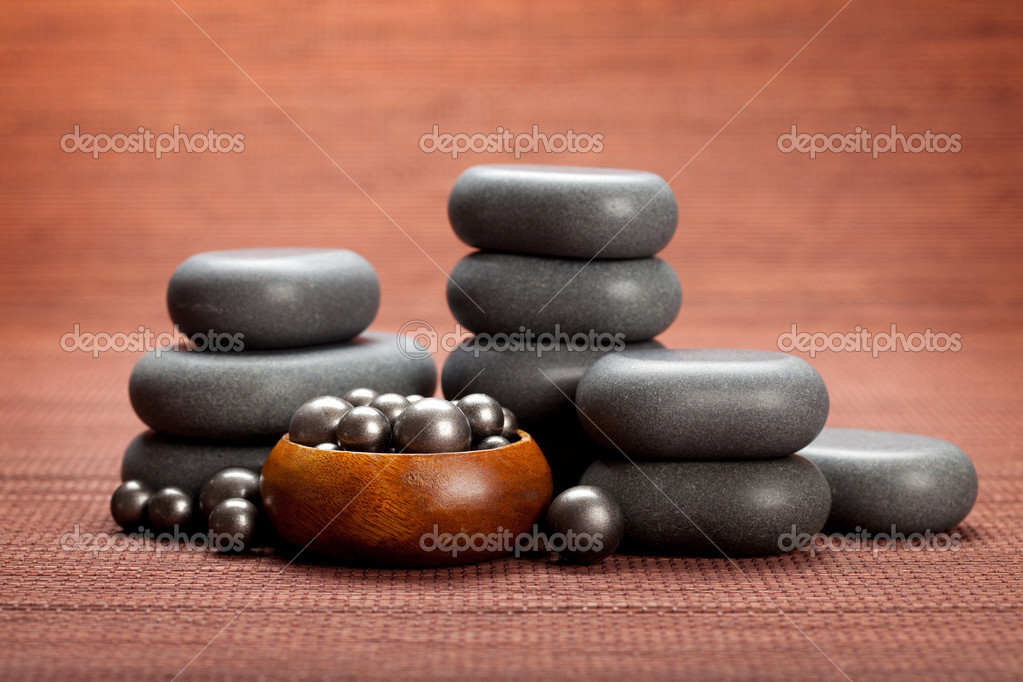 Spa massage - black stones — Stock Photo #6682323