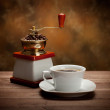 Coffee cup and grinder — Stock Photo