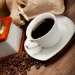 Black coffee - cup and grains — Stock Photo