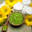 Yellow flowers and green spa minerals — Stock Photo