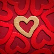 Royalty-Free Stock Photo: Golden heart on red hearts background