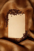 Coffee background - old paper and coffee beans — Stock Photo