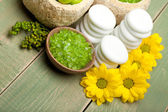 Flowers and green bath salt — Stock Photo