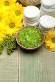 Aromatherapy - lime bath salt and yellow flowers — Stock Photo