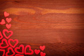 Red hearts on wooden background — Stockfoto