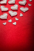 White hearts on red background — Stock Photo
