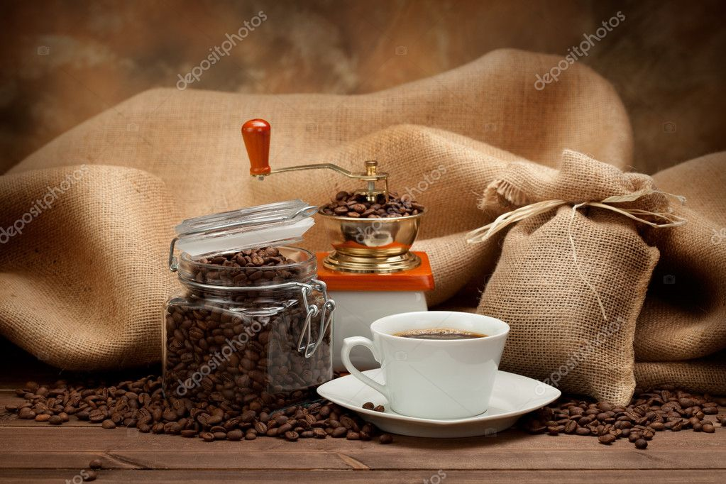 Coffee - cup of espresso, beans and grinder — Stock Photo #6696084