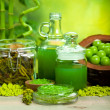 Stock Photo: Green salt and oils - aromatherapy