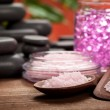 Spa treatment - pink minerals and black stones — Stock Photo