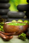 Green bath salt and black stones — Stock Photo