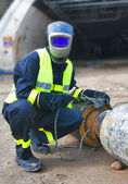 Welder covered with protective mask — Stock Photo