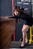 Woman playing eight ball — Stock Photo