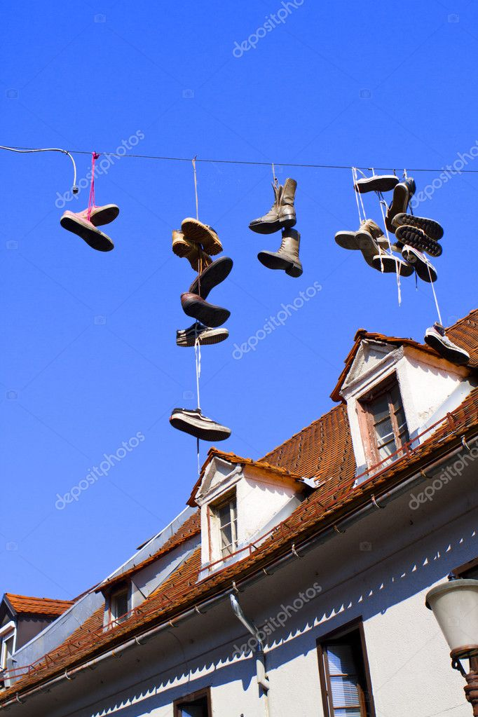 These shoes were dangling on a line in between houses. In English Cornwall this announces a death. — Stock Photo #6603925