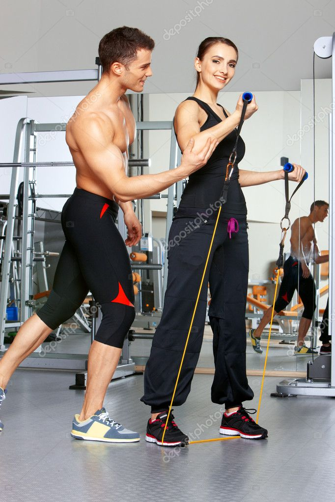 Sporty couple exercising at the fitness gym — Stock Photo #5420399