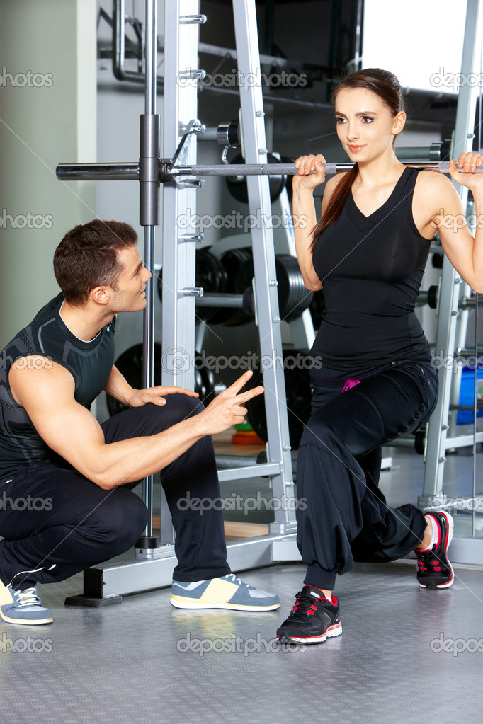 Sporty couple exercising at the fitness gym — Stock Photo #5420458