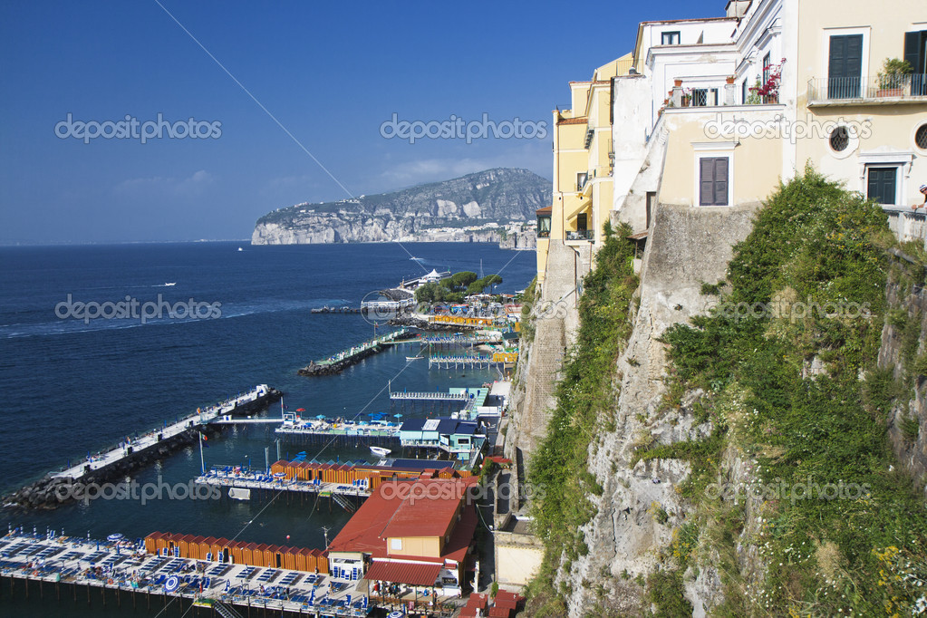 Italy: seascape of Sorrento with boats in the harbour — Stock Photo #6064536