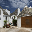Trullo (traditional house) at Alberobello, Puglia, Italy - Stock Photo