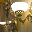 Stock Photo: Sconce near mirror in frame