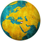 Syria flag on globe map — Stock Photo