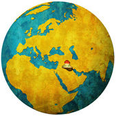 Iraq flag on globe map — Stock Photo