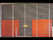 Orange Rooms behind metal Slats — Stock fotografie