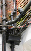 Wiring and piping, external fittings — Stock Photo
