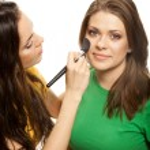 Woman applying blusher — Stock Photo #6468766