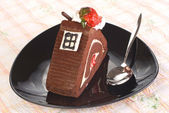 Piece of Chocolate cake with strawberry — Stock Photo