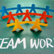 Royalty-Free Stock Photo: Teamwork words and colorful paper dolls