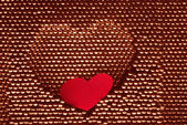 Red paper heart into steel herat shape — Stock Photo