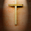 Wooden crucifix on the brick wall — Foto Stock