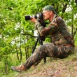 Professional photographer is taking wildlife photos — Stock Photo