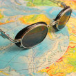 Map world and sunglasses. — Stock Photo