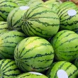 Stock Photo: Green watermelons on market stand