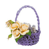 Wedding boutonniere and beads in a basket — Stock Photo