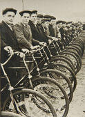 Men on bicycles, old photograph — Stock Photo