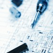 Stock Photo: Electronic components on schematic diagram background