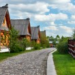 Traditional russian wooden houses in spring. - Stock Photo