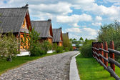 Traditional russian wooden houses in spring. — Stock Photo