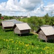 Russian wooden houses at a river bank. Huts on &quot;chicken legs&quot;. - Stock Photo