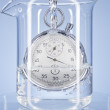 Stock Photo: Stopwatch in glass with water