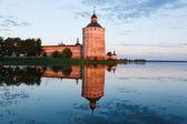 Torre de um mosteiro em um pôr do sol — Foto Stock