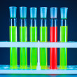 Six test tubes, one red — Stock Photo