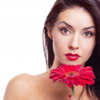 Woman with a flower — Stock Photo #5389061