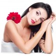 Woman with a flower — Stock Photo