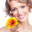 Woman with a flower - Stock Photo