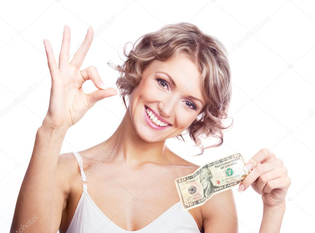 Beautiful young  woman holding money and showing us the sign OK — Stockfoto #5467848